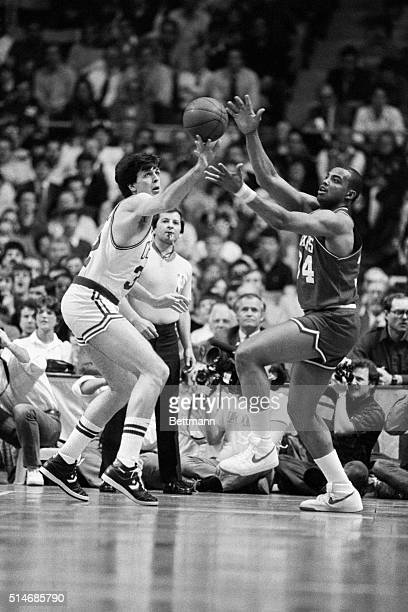 Boston Celtic Kevin McHale challenges Philadelphia 76er Charles Barkley for a loose ball in an NBA basketball game at Boston Garden March 29 1985