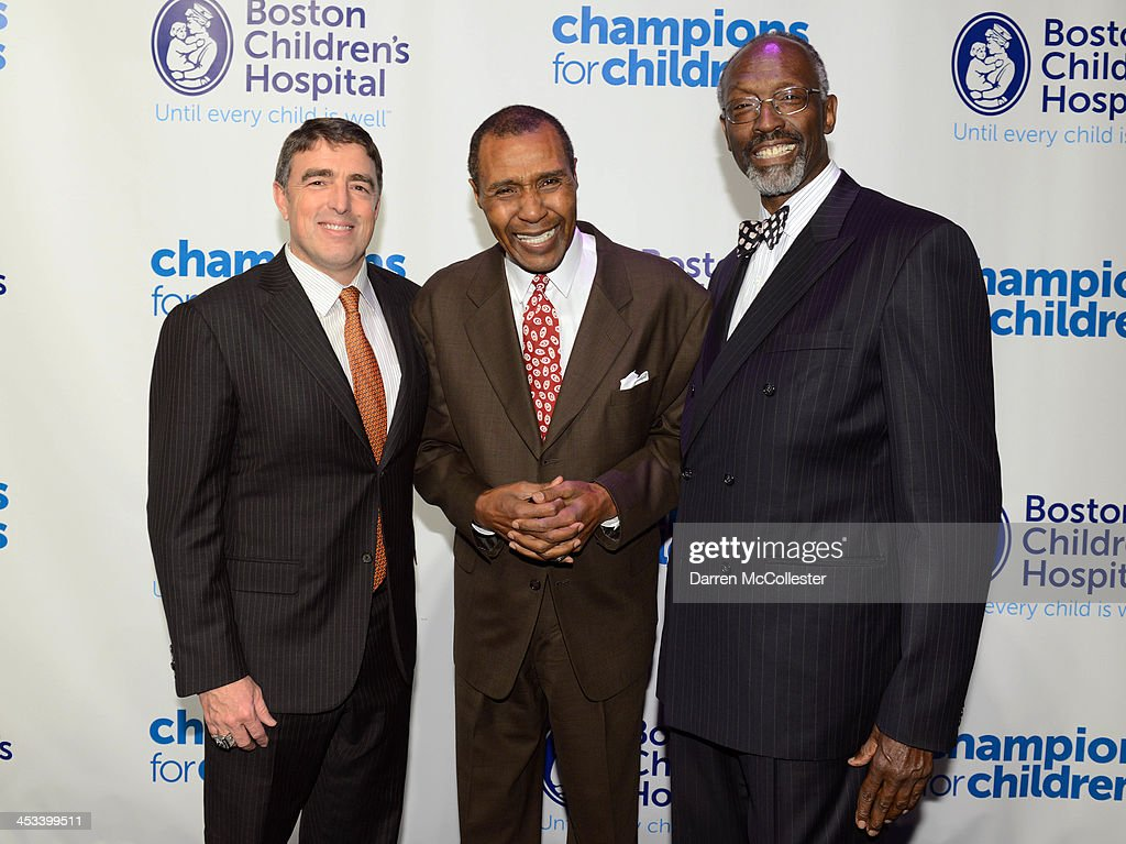 Boston Celtic owner Wyc Grousbeck, and former Celtic greats Jo Jo White and 'Satch' Sanders attend Champions for Children's at Seaport World Trade Center on December 3, 2013 in Boston, Massachusetts.