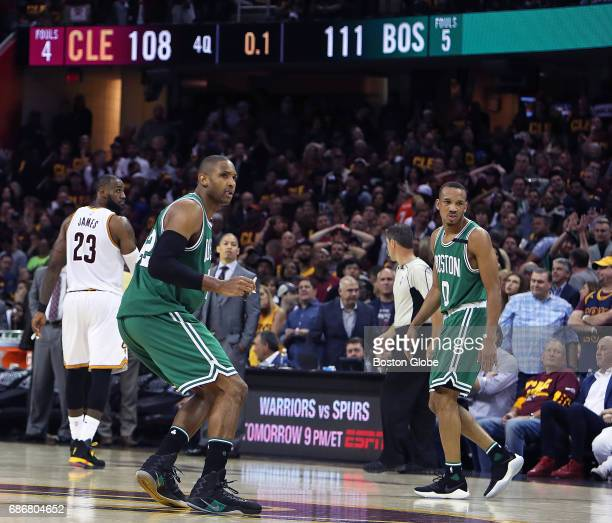 Boston Celtics Al Horford and teammate Avery Bradley celebrate after Bradley hit a three pointer with 1 seconds left in the game to give Boston an...
