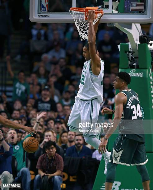 Boston Celtics' Al Horford makes the first of his three consecutive slam dunks in the fourth quarter this one over the Bucks' Giannis Antetokounmpo...
