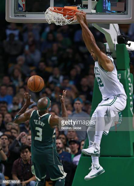 Boston Celtics' Al Horford makes the second of three consecutive slam dunks in the fourth quarter this one over the Bucks' Jason Terry The Boston...