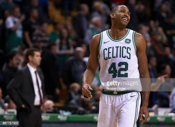 Boston Celtics' Al Horford reacts during the final seconds of the game as the clock ticks down to a Boston victory Head coach Brad Stevens stands at...