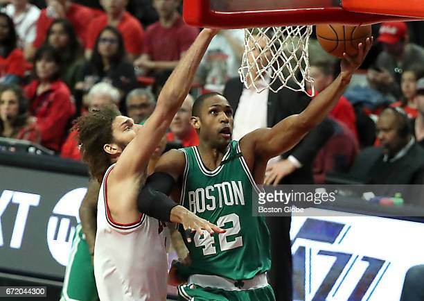 Boston Celtics' Al Horford scores a layup with pressure from Chicago Bulls' Robin Lopez during the first quarter The Boston Celtics visit the Chicago...