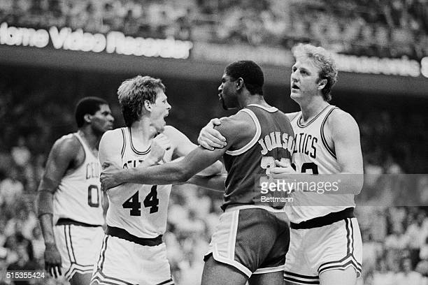 Boston Celtics' basketball player Larry Bird restraining Los Angeles Lakers' Magic Johnson from punching Celtics' Danny Ainge Tempers flared during...