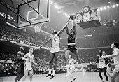 Celtics' Bill Russell harasses 76ers' Wilt Chamberlain as he attempts to score 2nd quarter action Boston Garden Celtics' John Havlicek