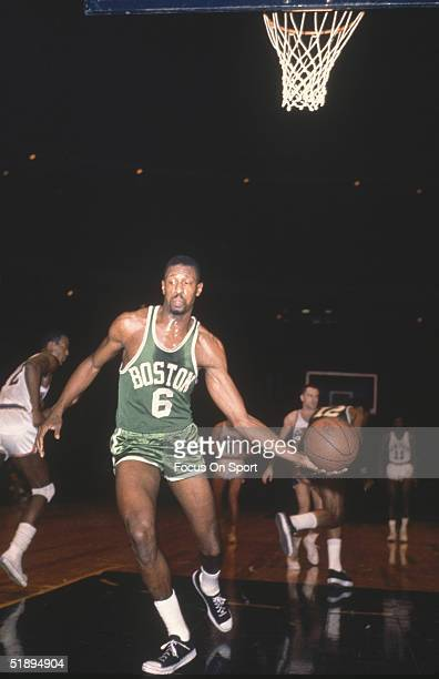 Boston Celtics' Bill Russell takes the grabs the rebound to pass after a score by the New York Knicks at Madison Square Garden in New York New York