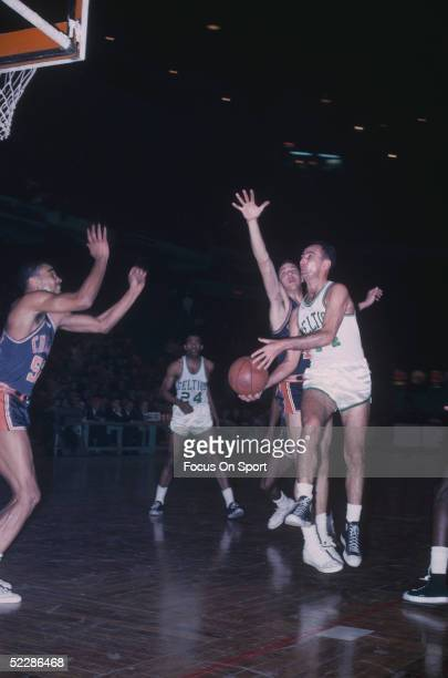Boston Celtics' Bob Cousy looks to pass near the net during a game in 1963 at the Boston Garden in Boston Massachusetts