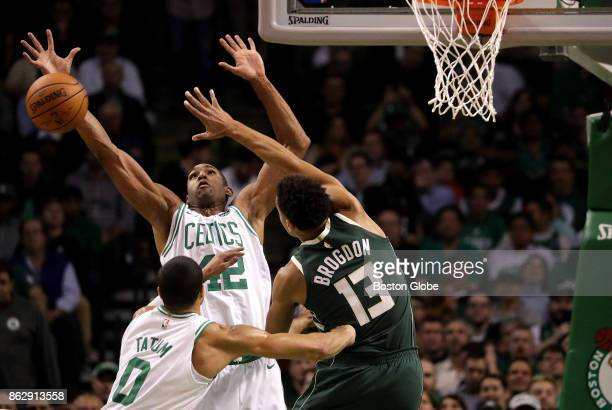 Boston Celtics center Al Horford and Boston Celtics forward Jayson Tatum double down defensively on Milwaukee Bucks guard Malcolm Brogdon during the...