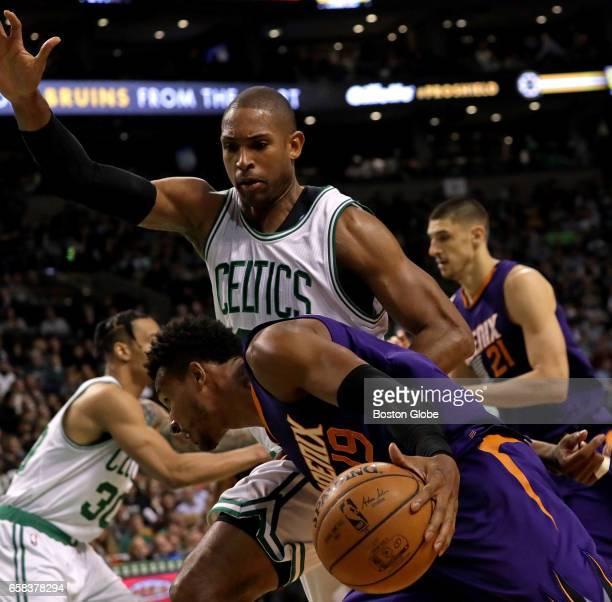 Boston Celtics center Al Horford is there to stop Phoenix Suns guard Leandro Barbosa's drive in the second quarter The Boston Celtics host the...