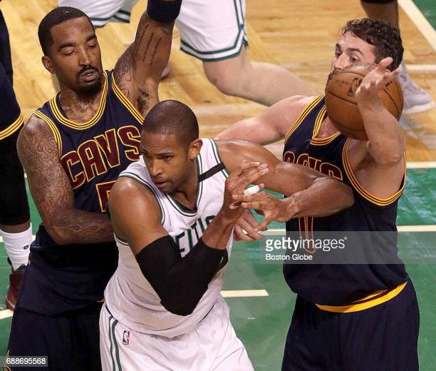 Boston Celtics center Al Horford loses the ball as he is double teamed during the third quarter The Boston Celtics host the Cleveland Cavaliers in...