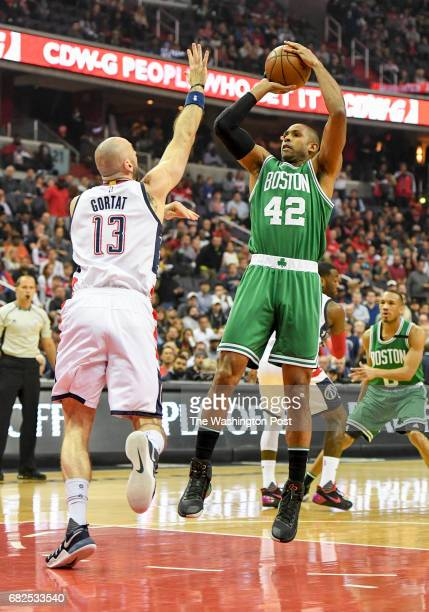 Boston Celtics center Al Horford shoots over Washington Wizards center Marcin Gortat during game six of the Eastern Conference semifinals in...