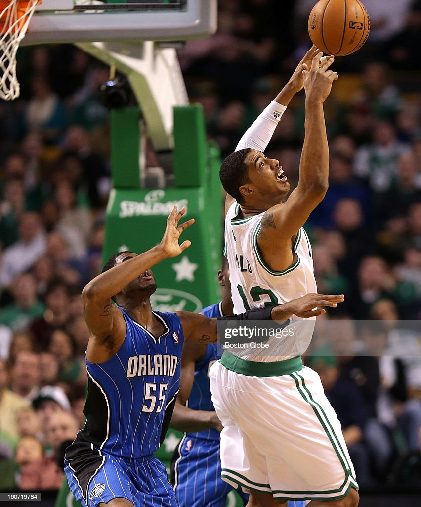 Boston Celtics center Fab Melo (#13) battles for a rebound as he got into the game late in the fourth quarter as the Boston Celtics take on the Orlando Magic at TD Garden.