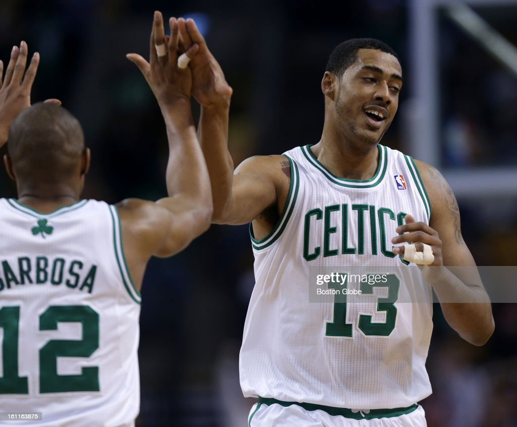 Boston Celtics center Fab Melo (#13) gets a hand from Boston Celtics shooting guard Leandro Barbosa (#12) after scoring late in garbage time as the Boston Celtics play the Los Angeles Lakers at TD Garden.
