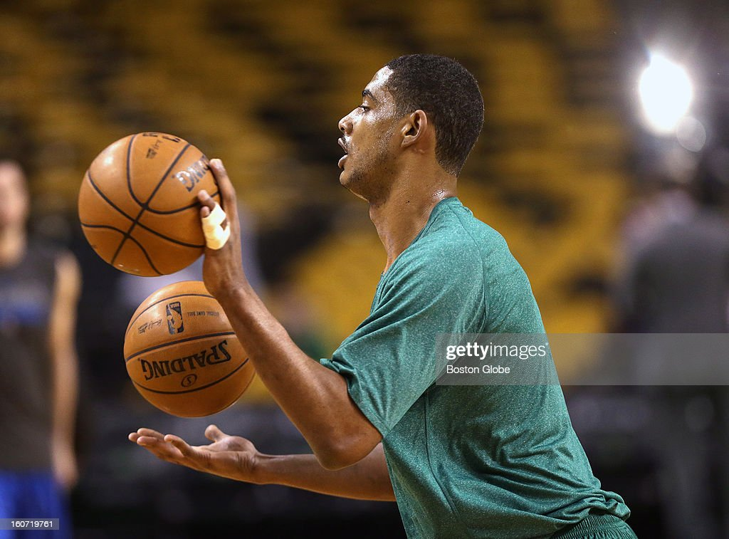 Boston Celtics center Fab Melo (#13) warms up with pre game drills after being called up for tonight's game against the Orlando Magic at TD Garden.