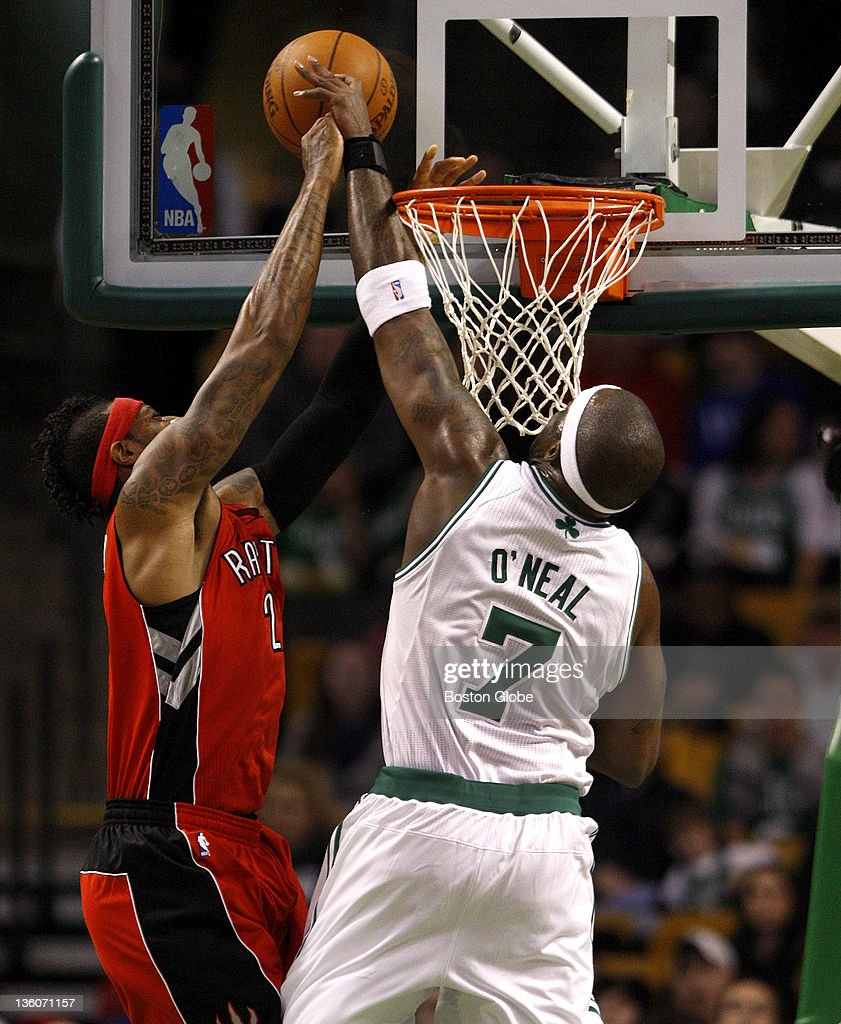 Boston Celtics center Jermaine O'Neal blocks a shot by Toronto Raptors small forward James Johnson during the first quarter