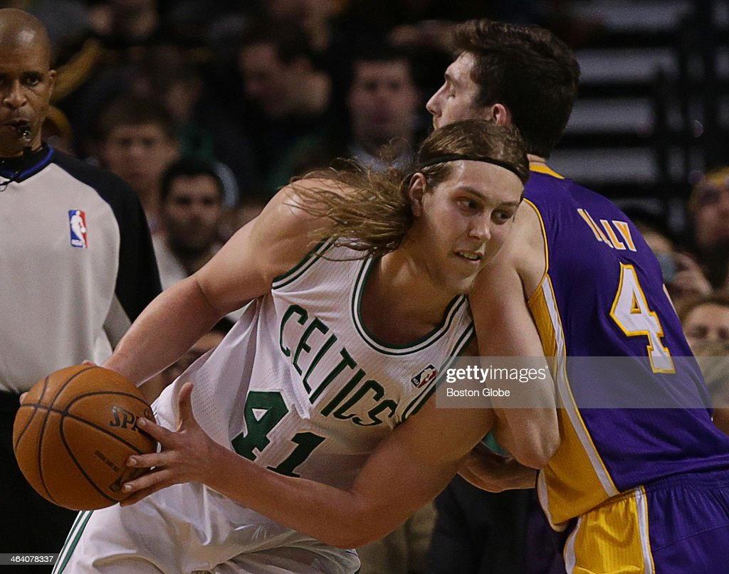 Boston Celtics center Kelly Olynyk (#41) drives to the basket on Los Angeles Lakers power forward <a gi-track='captionPersonalityLinkClicked' href=/galleries/search?phrase=Ryan+Kelly+-+Giocatore+di+basket&family=editorial&specificpeople=15185169 ng-click='$event.stopPropagation()'>Ryan Kelly</a> (#4) in the fourth quarter. Boston Celtics point guard Rajon Rondo (#9) returns to action against the Los Angeles Lakers at TD Garden in his first game back since suffering a season ending knee injury in 2013.