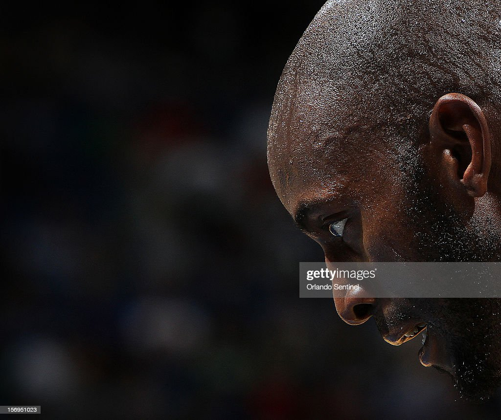 Boston Celtics center Kevin Garnett takes a rest during a Orlando Magic free throw attempt during their game at the Amway Center on Sunday, November 25, 2012, in Orlando, Florida. The Celtics won the game 116-110.