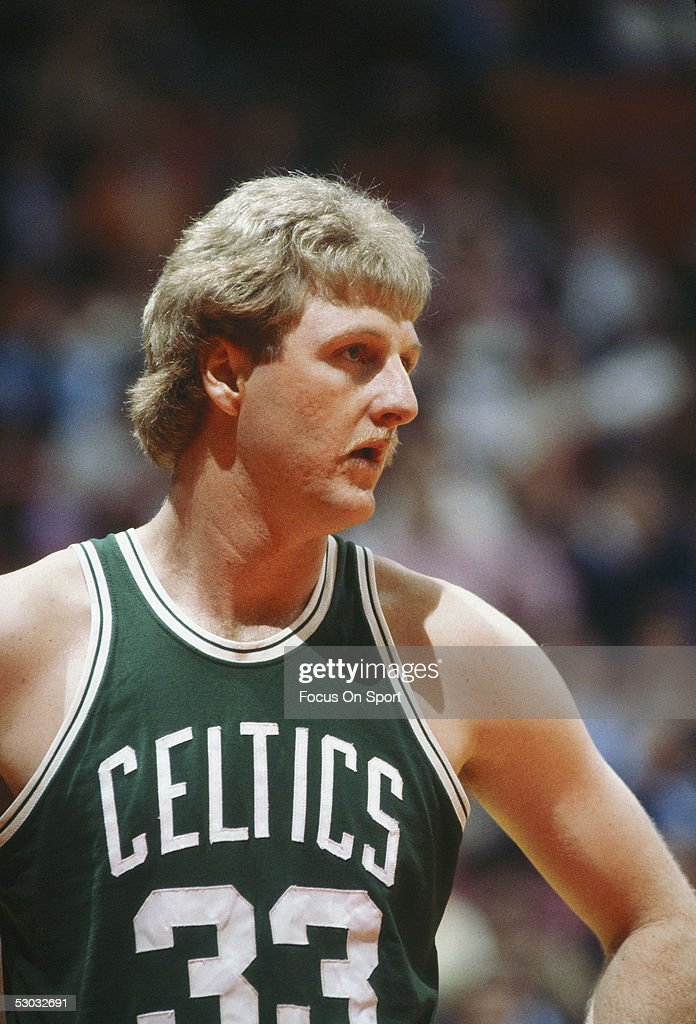 Boston Celtics' center Larry Bird stands on the court during a game NOTE TO USER User expressly acknowledges and agrees that by downloading and/or...