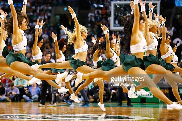 Boston Celtics cheerleaders leap in the air during a timeout during Game Three of the Eastern Conference Quarterfinals of the 2013 NBA Playoffs...