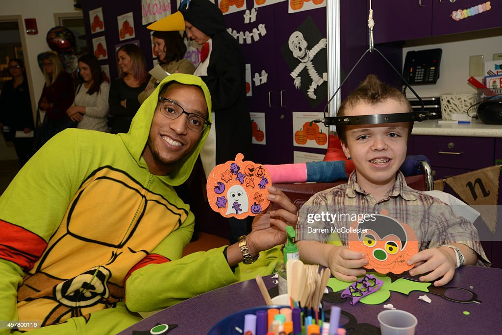 Boston Celtics Evan Turner spends time Alex with at Boston Children's Hospital October 24, 2014 in Boston, Massachusetts.