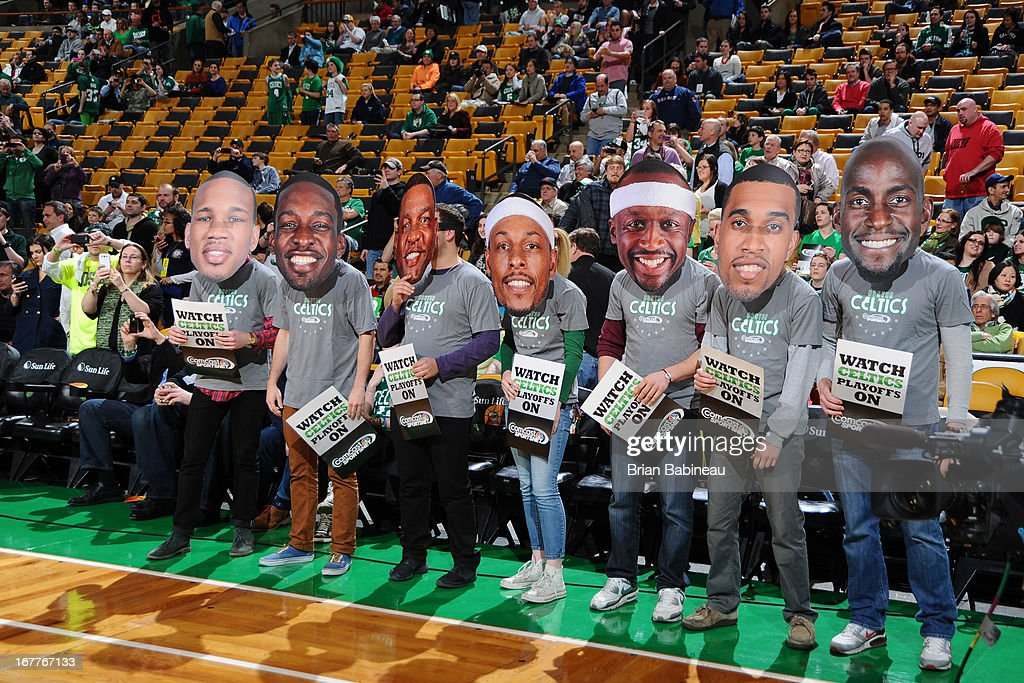 Boston Celtics fans wear cut-outs of the players during the game against the Detroit Pistons on April 3, 2013 at the TD Garden in Boston, Massachusetts.