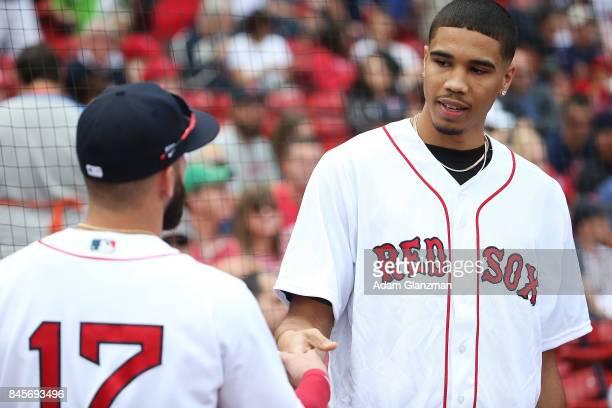 Boston Celtics first round draft pick Jayson Tatum greets Deven Marrero of the Boston Red Soxat Fenway Park on September 10 2017 in Boston...