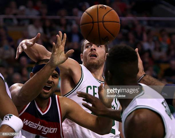 Boston Celtics forward David Lee looks for the block on Washington Wizards guard Jared Dudley during the second half The Boston Celtics take on the...