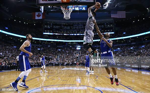 TORONTO ON JANUARY 10 Boston Celtics forward Gerald Green launches for a slam dunk as the Toronto Raptors wearing their throw back Toronto Huskies...