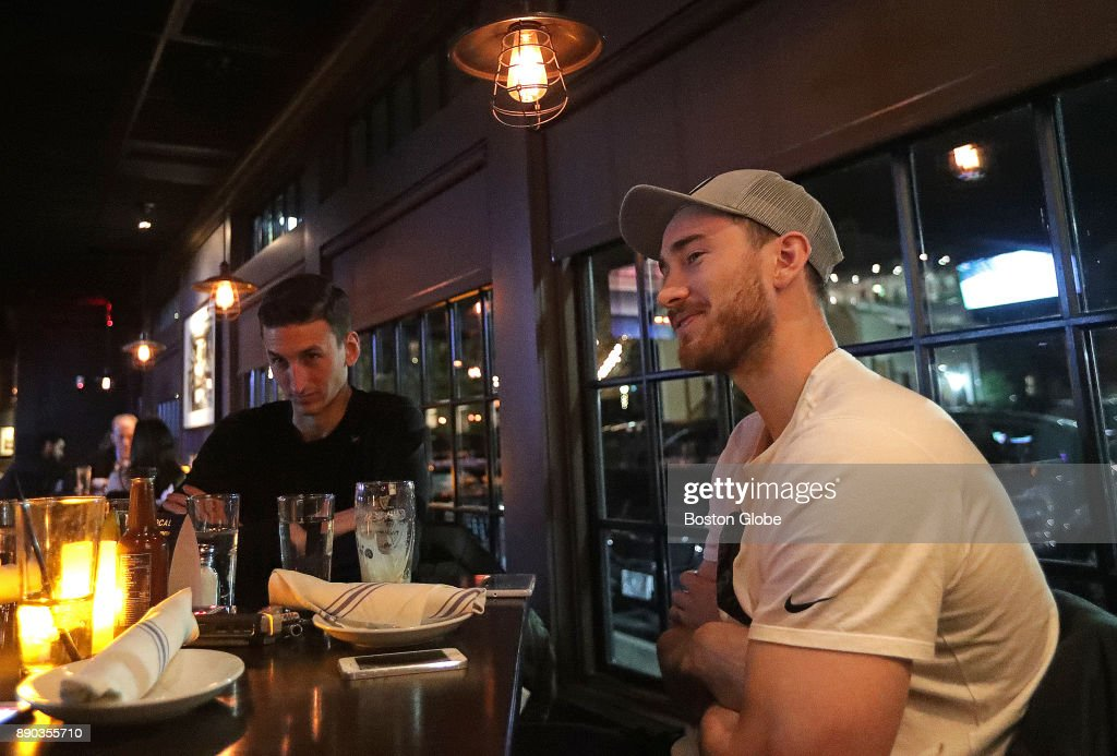 Boston Celtics forward Gordon Hayward watches the Boston Celtics take on the San Antonio Spurs on televisions at The Local in Wellesley, MA on Dec. 9, 2017. At left is his trainer Jason Smeathers. Hayward joined Boston Globe reporter Adam Himmelsbach to watch the game and discuss his recovery from a gruesome ankle injury in the first game of the season, his team, and his eventual return.