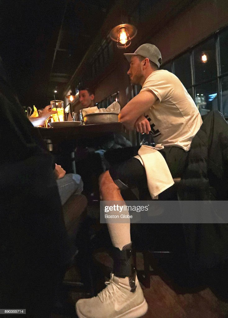 Boston Celtics forward Gordon Hayward watches the Boston Celtics take on the San Antonio Spurs on television at The Local in Wellesley, MA, while wearing a brace for his ankle injury, on Dec. 8, 2017. Hayward joined Boston Globe reporter Adam Himmelsbach to watch the game and discuss his recovery from a gruesome ankle injury in the first game of the season, his team, and his eventual return.