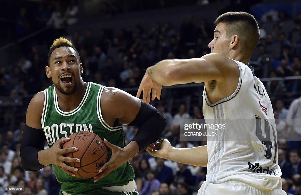 Boston Celtics' forward Jared Sullinger vies with Real Madrid's Swedish forward Jeffery Taylor during their NBA Global Games Madrid 2015 basketball...