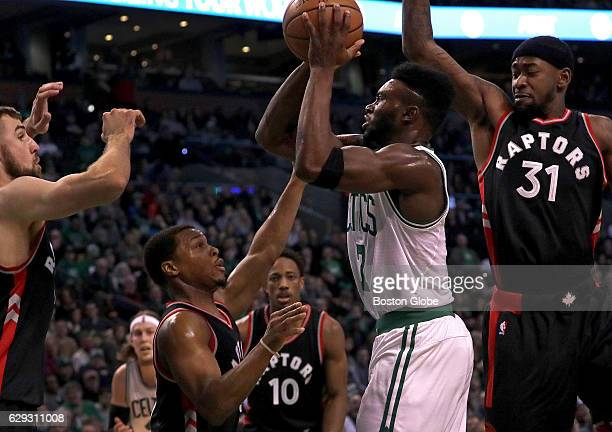 Boston Celtics forward Jaylen Brown finds his lane blocked by a host of Toronto Raptors as he pulls up for a shot during the second quarter The...
