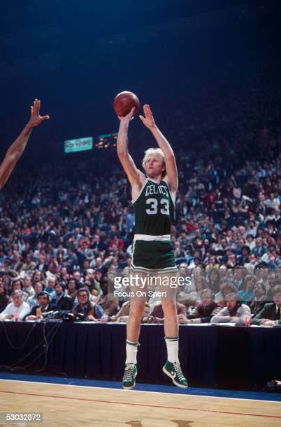 Boston Celtics' forward Larry Bird jumps and shoots from the corner against the Washington Bullets during a game at Capital Centre circa the 1980's...