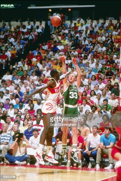Boston Celtics forward Larry Bird shoots over Atlanta Hawks forward Dominique Wilkins during game at The Omni in Atlanta Georgia NOTE TO USER User...