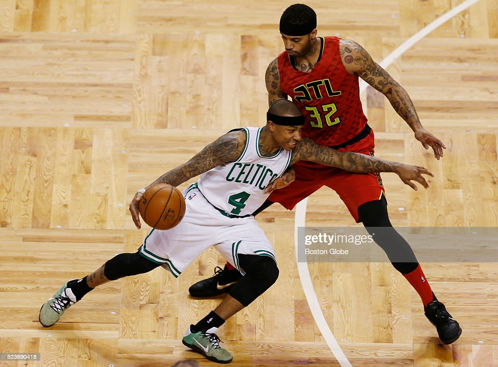 Boston Celtics guard Isaiah Thomas drives past Atlanta Hawks forward Mike Scott during the first quarter of Game 4 of the first round of the Eastern...