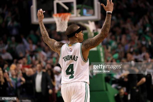 Boston Celtics guard Isaiah Thomas exhorts the fans to give it up as the final seconds wind down in overtime with Boston taking Game 2 129119 The...
