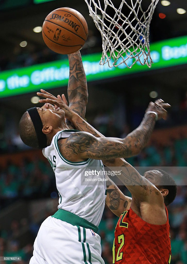 Boston Celtics guard Isaiah Thomas gets a face full of Atlanta Hawk player Mike Scott as he drives to the hoop in the fourth quarter of Game 6 in the...