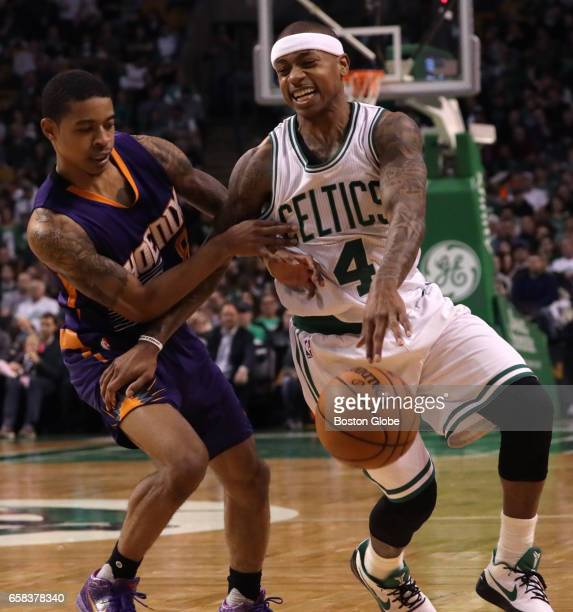 Boston Celtics guard Isaiah Thomas is fouled by Phoenix Suns guard Tyler Ulis on this drive in the third quarter The Boston Celtics host the Phoenix...