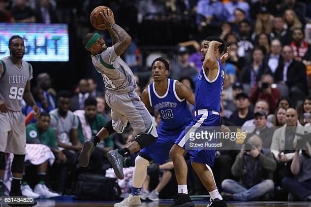 TORONTO ON JANUARY 10 Boston Celtics guard Isaiah Thomas looks to dish off the ball as the Toronto Raptors wearing their throw back Toronto Huskies...