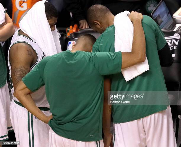 Boston Celtics guard Marcus Smart Boston Celtics guard Avery Bradley and Boston Celtics center Al Horford comfort each other during a timeout late in...