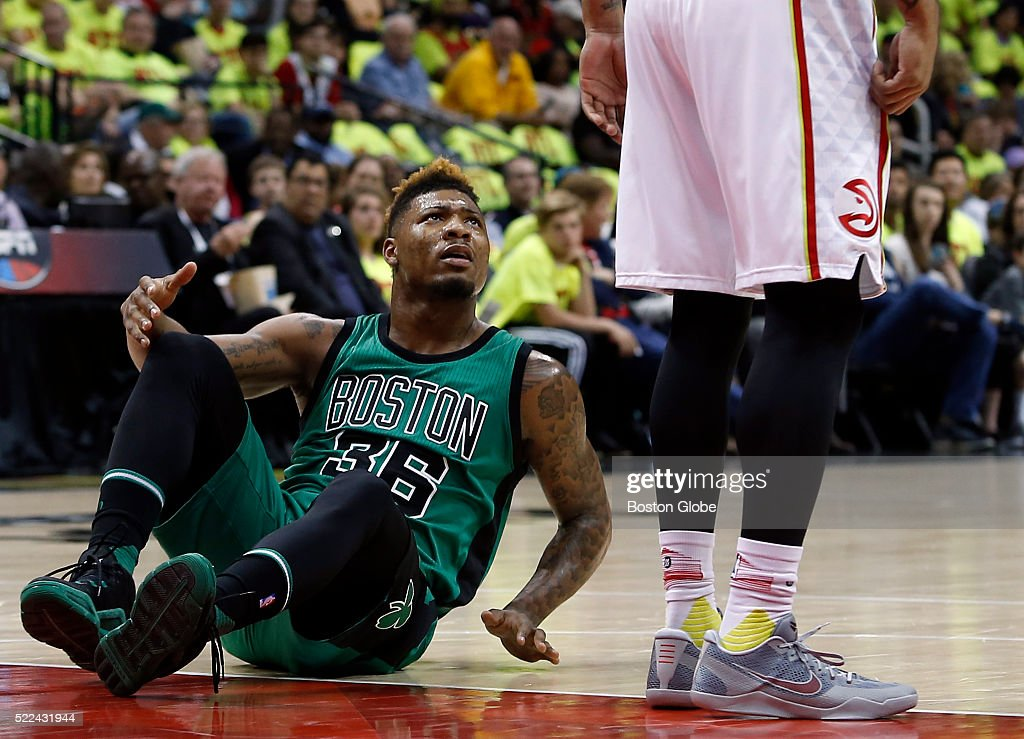 Boston Celtics guard Marcus Smart left reacts to Atlanta Hawks forward Mike Scott after he was fouled during the second quarter of Game 1 in the...