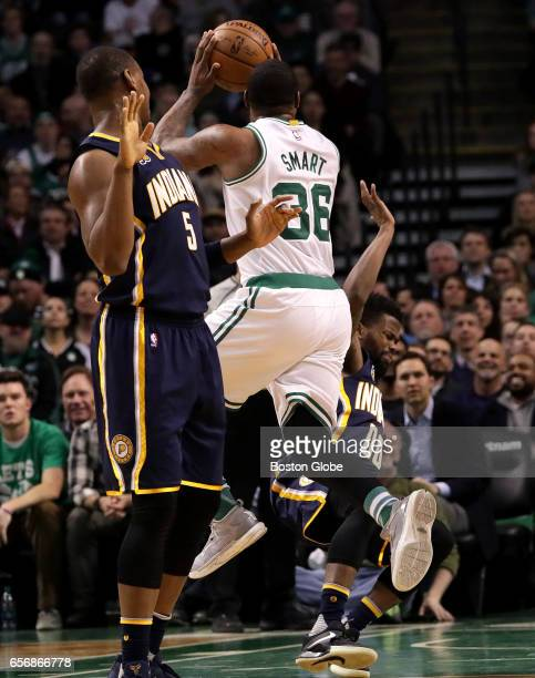Boston Celtics guard Marcus Smart puts up an off balance shot as he is fouled by Indiana Pacers guard Aaron Brooks on this play in the third quarter...