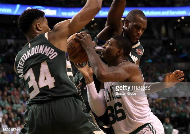 Boston Celtics guard Marcus Smart tries to split the defense of Milwaukee Bucks forward Giannis Antetokounmpo and Milwaukee Bucks forward Thon Maker...