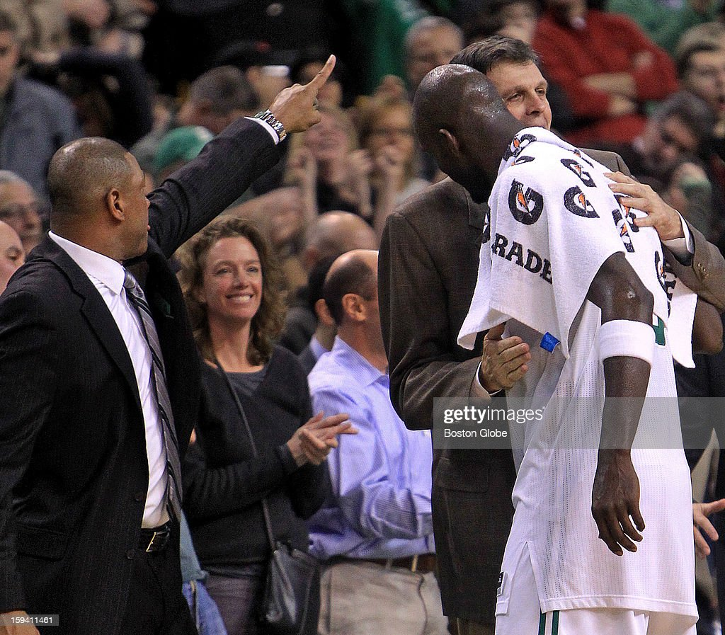 Boston Celtics head coach Doc Rivers and Boston Celtics power forward Kevin Garnett (#5) got together with Houston Rockets head coach Kevin McHale at the end of the game as the Boston Celtics play the Houston Rockets at TD Garden.