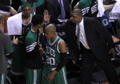Boston Celtics head coach Doc Rivers reaches out to give Boston Celtics small forward Paul Pierce a conciliatory pat on the back as he took out his...