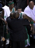 Boston Celtics head coach Doc Rivers shares a emotional hug with Boston Celtics power forward Kevin Garnett in the closing moments of game seven...