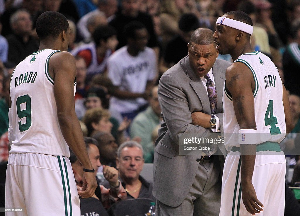 Boston Celtics head coach Doc Rivers talks to Boston Celtics point guard Rajon Rondo (#9) and Boston Celtics shooting guard Jason Terry (#4) during the fourth quarter as the Celtics play the Philadelphia 76ers at TD Garden.