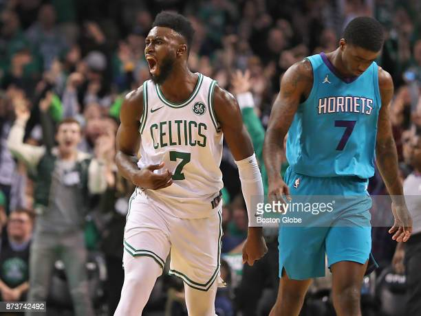 Boston Celtics' Jaylen Brown reacts after making a threepoint basket in front of Charlotte Hornets' Dwayne Bacon during the fourth quarter The Boston...