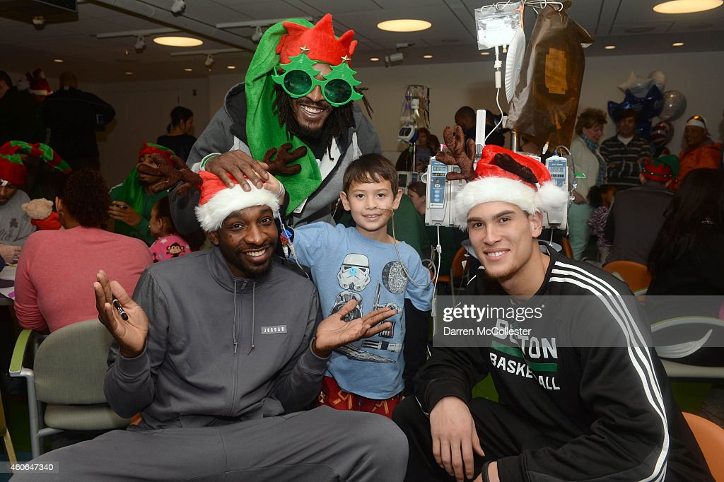 Boston Celtics Jeff Green, Gerald Wallace, and Dwight Powell spend time with Ryan at Boston Children's Hospital December 18, 2014 in Boston, Massachusetts.