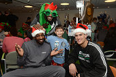 Boston Celtics Jeff Green Gerald Wallace and Dwight Powell spend time with Ryan at Boston Children's Hospital December 18 2014 in Boston Massachusetts